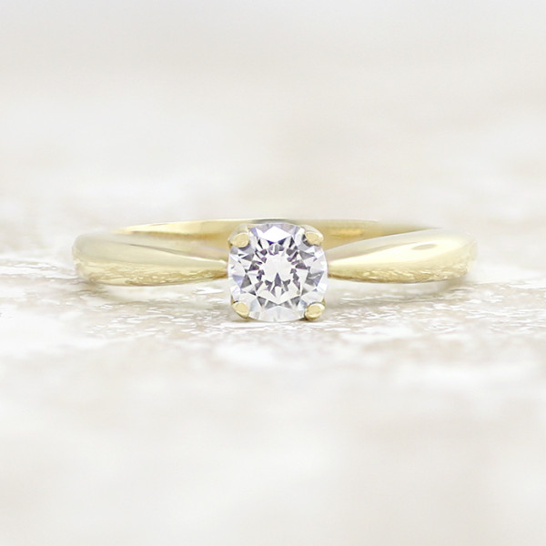 Tiffany-Style Solitaire with 0.56 carat Round Brilliant Center - 14k Yellow Gold - Ring Size 5.75-11.75
