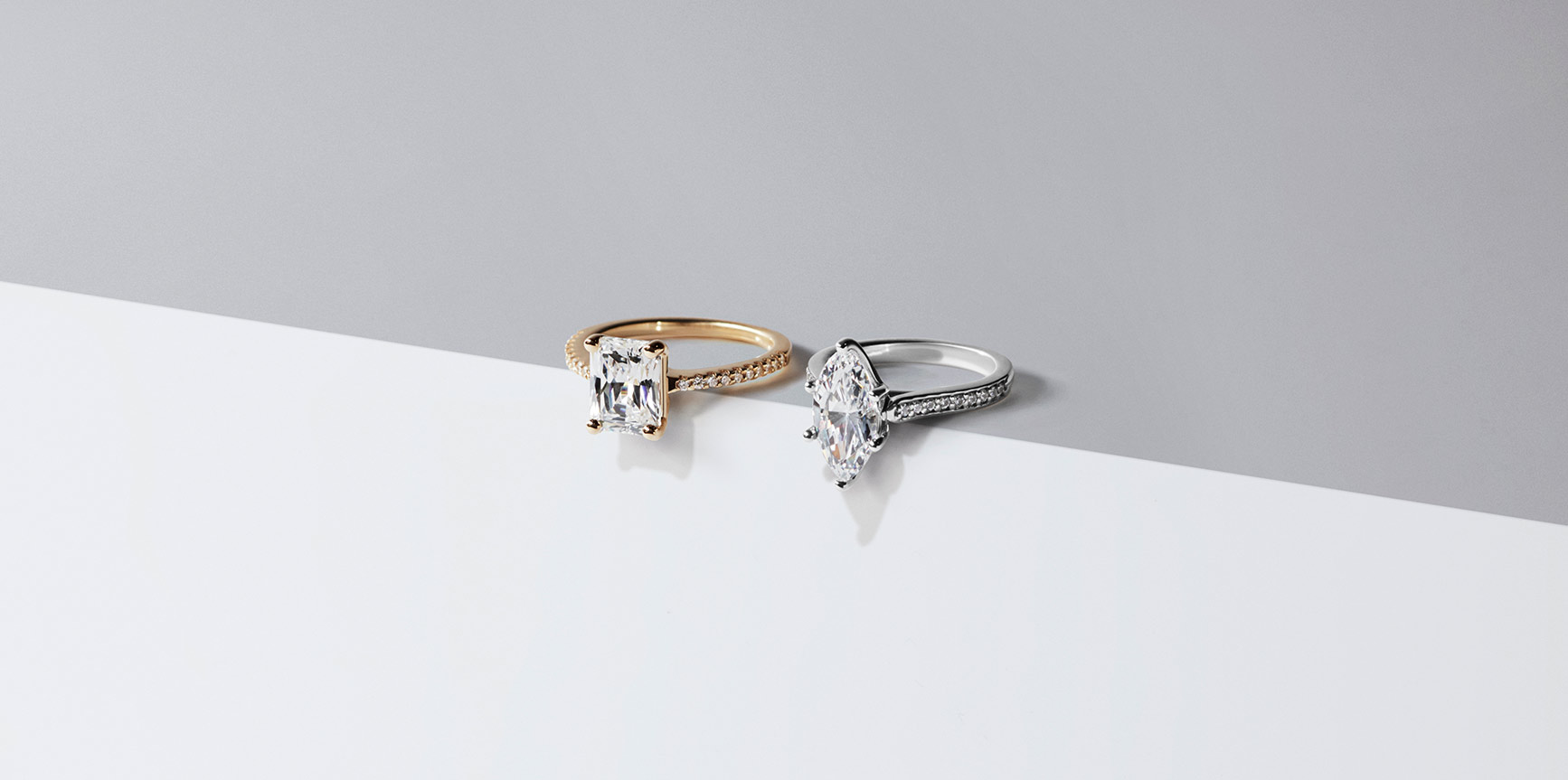 Two accented solitaire engagement rings set with Nexus Diamond™ alternatives.