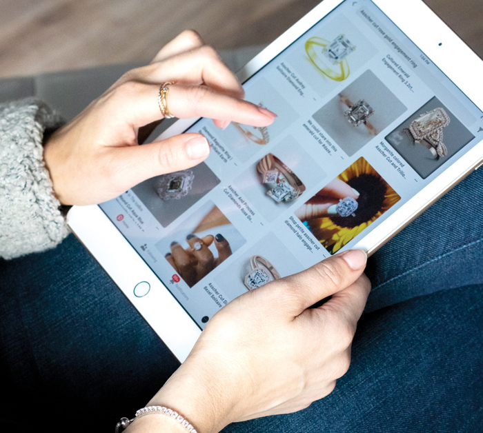 A tablet featuring a Pinterest search for engagement rings