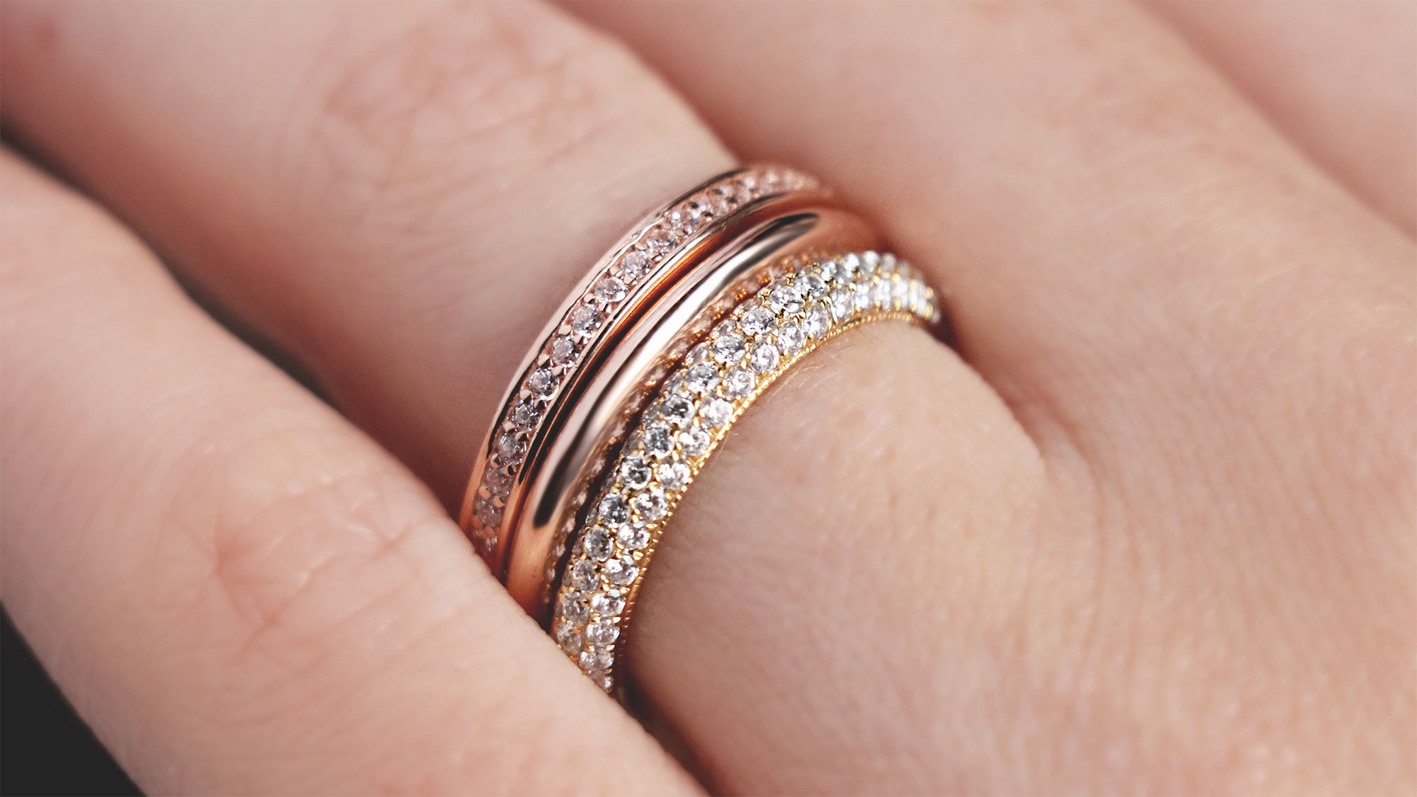 A mixed-metal ring stack featuring accented and classic styles.