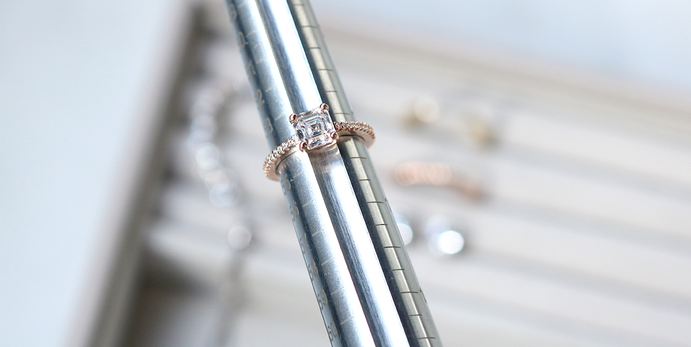 A Diamond Nexus engagement ring being measured with a mandrel.