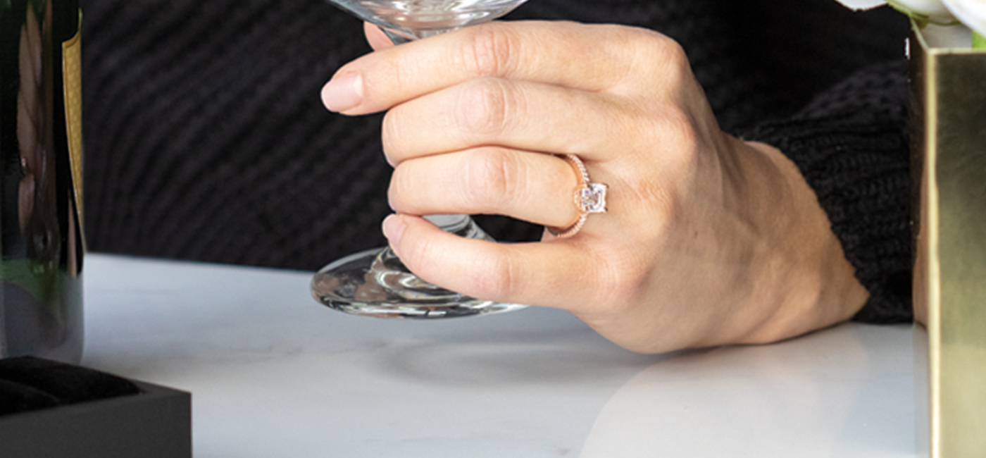 A Diamond Nexus engagement ring featured on a hand.