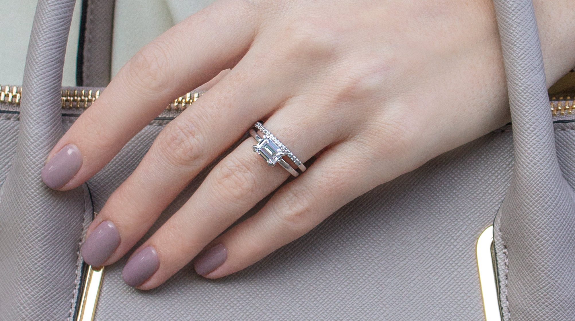 A classic wedding set from Diamond Nexus featured on a hand.