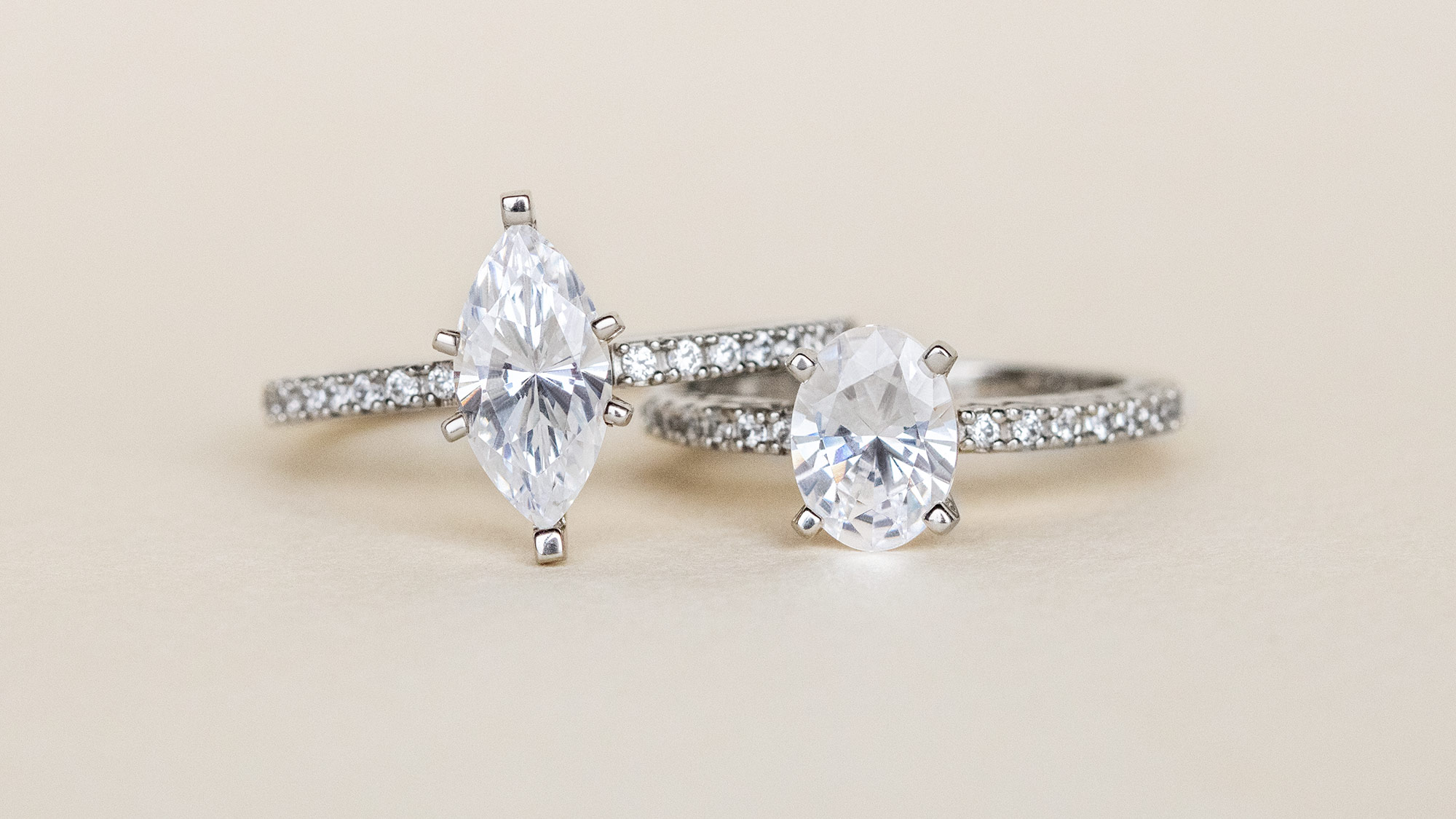 Two accented Diamond Nexus engagement rings featuring different stone shapes.
