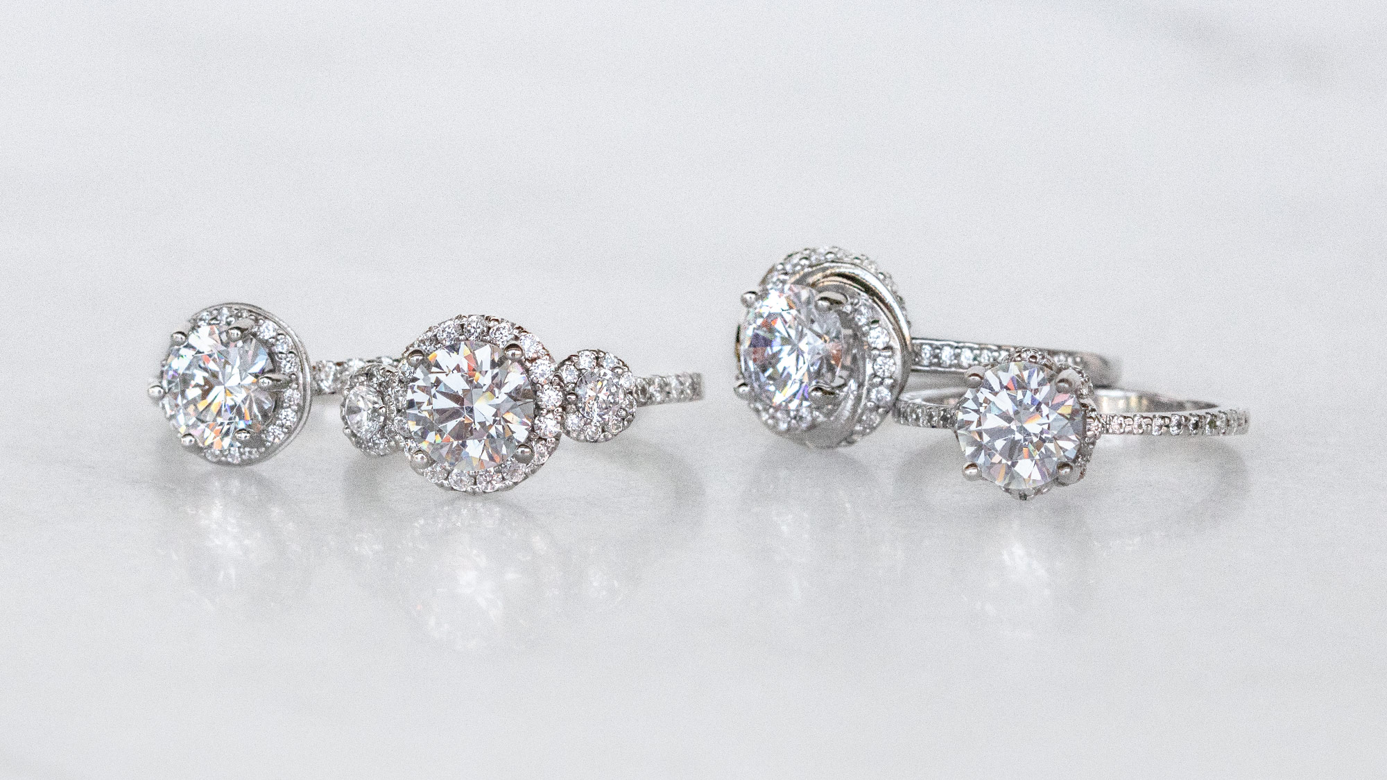 Multiple halo engagement rings from Diamond Nexus.