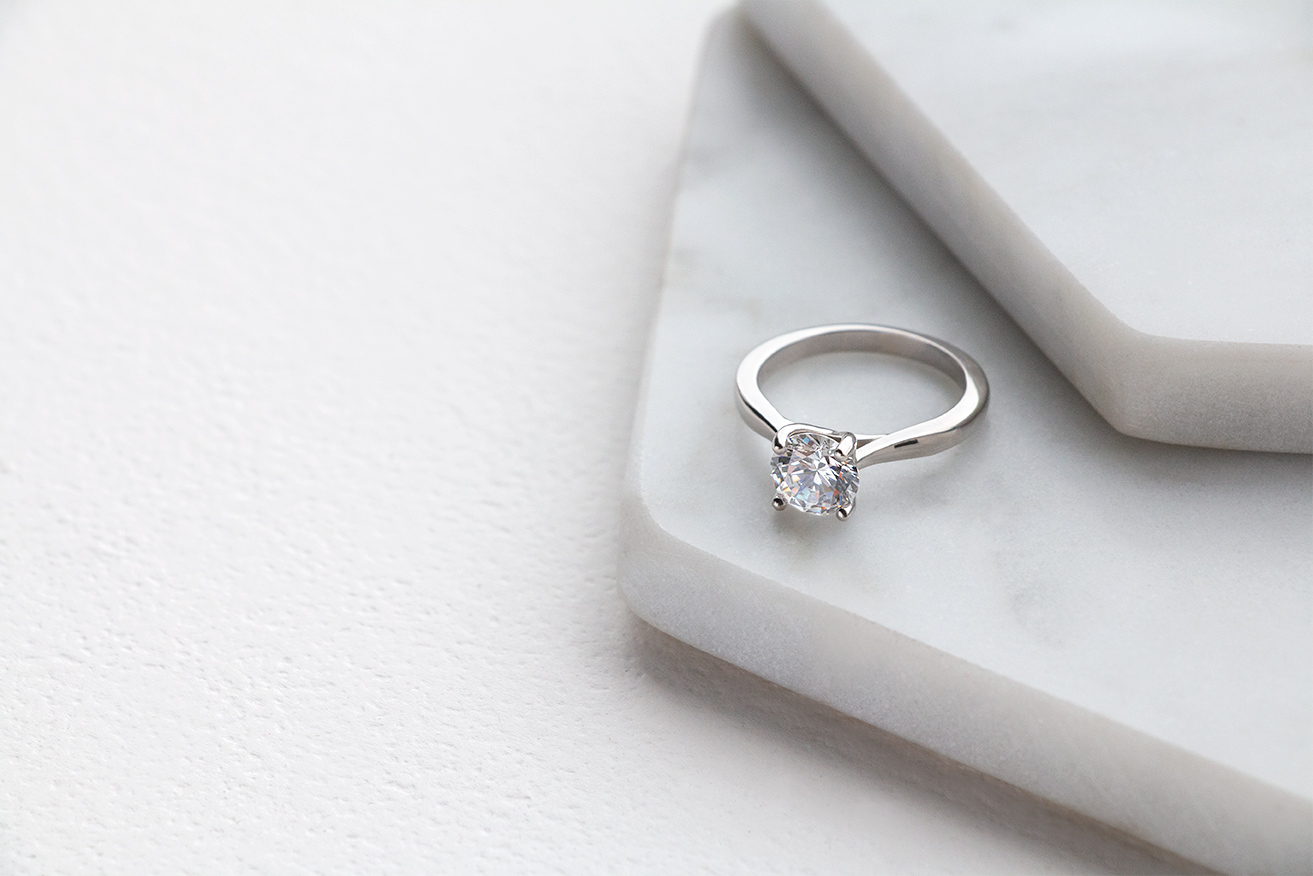 A solitaire Diamond Nexus engagement ring featuring a Round Brilliant center stone.
