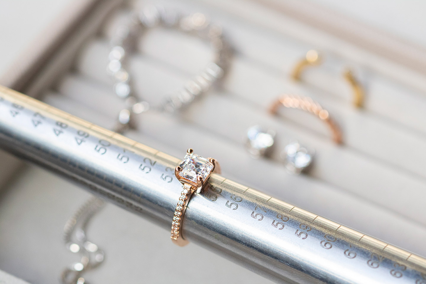 A Diamond Nexus engagement ring being sized on a ring mandrel.