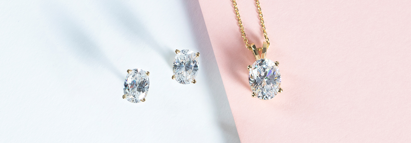 Nexus Diamond alternatives set in a pair of earrings and pendant with perfect standards of cut, color and clarity.