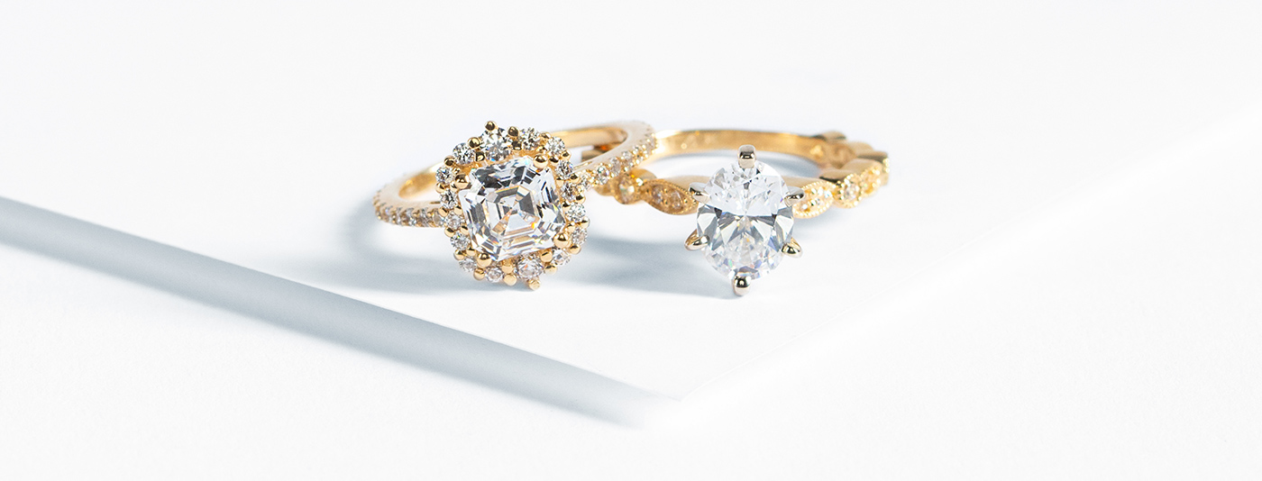 Engagement rings from Nexus Diamond featuring yellow gold metal type and Nexus Diamond alternatives.