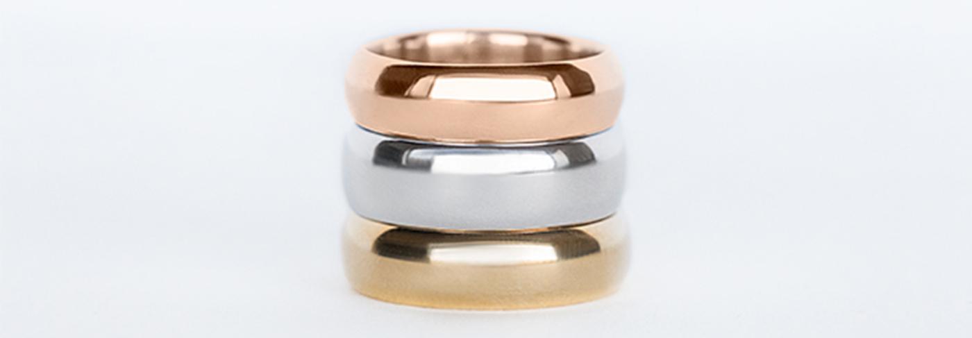 Three Diamond Nexus wedding bands in white, yellow and rose gold