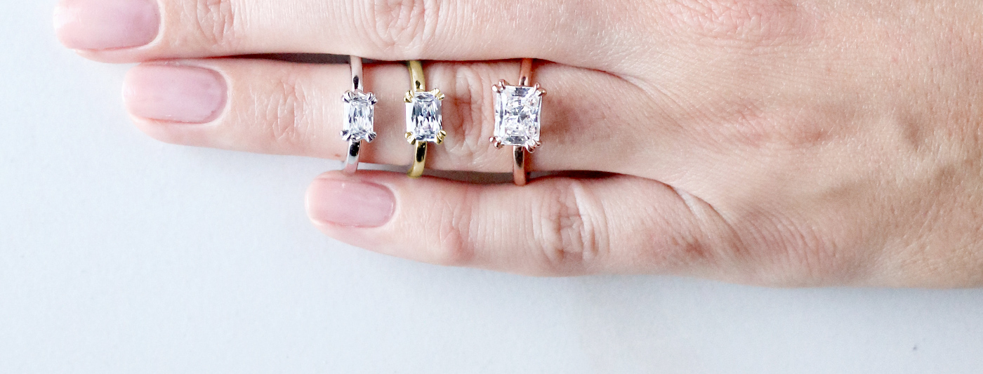 Three solitaire Nexus Diamond engagement rings featuring Radiant cut Nexus Diamond alternatives