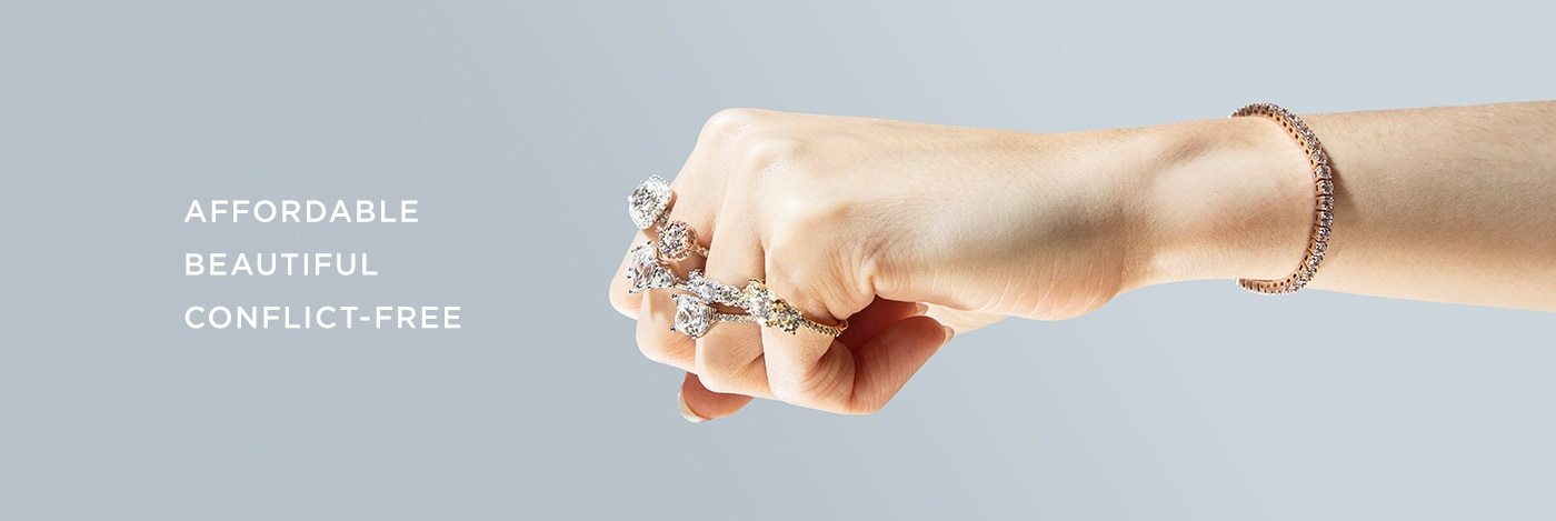 A fist wearing affordable, beautiful and conflict-free engagement rings set with Nexus Diamond alternatives.
