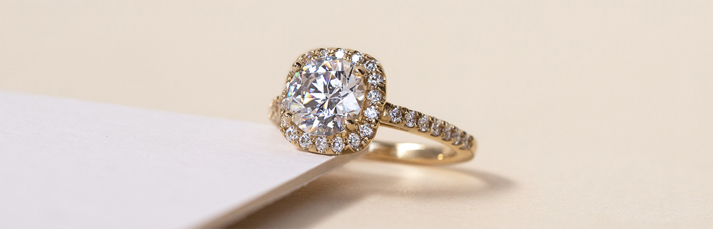A Diamond Nexus halo engagement ring set with Nexus Diamond alternatives.